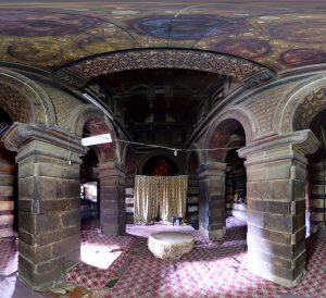"""Figure 2 Inside of Yemrehanna Kristos (from panorama). The """"Holy of Holies"""" is hidden behind the curtain, two closed sacred rooms are on the left and right"""